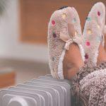 little-girls-feet-in-slippers-on-radiator-heater-picture-id1202108660