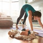 keeping-an-eye-on-her-baby-while-keeping-in-shape-picture-id628295056