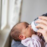 daddy-feeding-newborn-baby-picture-id1129631965