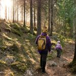 mother-and-her-daughter-on-the-hiking-trail-on-kallio-lake-finland-picture-id1222408730 (1)