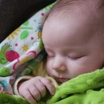 baby-sleeping-in-a-pram-picture-id952531242