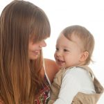 young-mom-or-nanny-sharing-intimate-laughter-with-little-boy-picture-id669409426