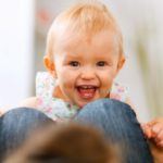Portrait of smiling playing baby at home
