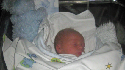 Julegutten Marcus - som ble født i ambulansen.
