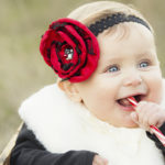 Adorable Baby with Candy Cane outdoors – Christmas Card