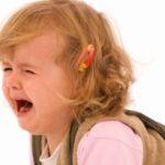 Extremely sad baby girl crying – isolated over white