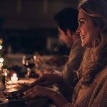 beautiful-woman-having-christmas-dinner-with-family-picture-id863577820