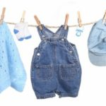All Boy Clothing Hanging on a Clothesline Isolated on White Background