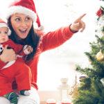 Mother and her baby boy enjoying Christmas