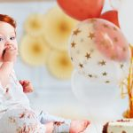 funny-infant-baby-boy-tasting-his-1st-birthday-cake-picture-id925083876