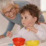 grandmother-feeding-her-grandson-picture-id1177709071