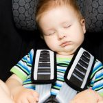 toddler-boy-sleeping-peacefully-in-his-baby-car-seat-picture-id182869514