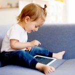 cute-girl-using-digital-tablet-picture-id1036734486