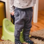 child-preparing-to-sit-on-the-potty-picture-id1217039677