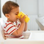 portrait-of-boy-drinking-milk-on-an-open-cup-picture-id958751912