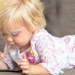 child-playing-with-a-smart-phone-picture-id1041258094