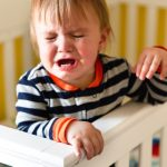 baby-crying-in-crib-picture-id510158004