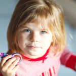little-cute-toddler-girl-making-experiment-with-scissors-and-cutting-picture-id1297568482