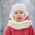 happy-child-playing-with-snow-picture-id1297092613