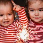 family-holidays-at-home-two-happy-kids-holding-burning-sparkler-picture-id1283892809