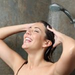 happy-woman-showering-and-singing-picture-id1159619888