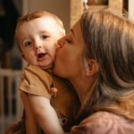 mother-kissing-and-hugging-her-child-picture-id1299790638