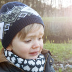 beautiful boy crying at sunset