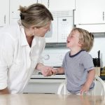 Mother trying to calm crying child at home