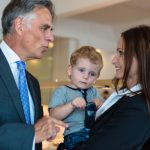 businesswoman-with-small-child-in-the-office-picture-id177889389