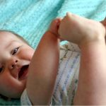 baby-playing-with-toes-picture-id89958706
