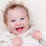 baby-girl-on-knitted-blanket-picture-id4978009521