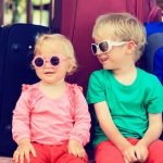 kids-sitting-on-suitcases-ready-to-travel-picture-id471322386