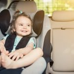 infant-baby-girl-buckled-into-her-car-seat-picture-id815352734-2