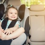 infant-baby-girl-buckled-into-her-car-seat-picture-id815352734-1
