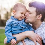 young-father-with-a-toddler-boy-playing-outside-picture-id961247502