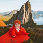 baby-on-camping-mat-in-mountains-family-vacations-adventure-healthy-picture-id1278454210