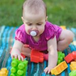 baby-play-whit-toy-block-outdoors-picture-id1209622820