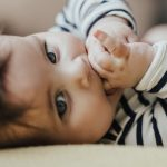 adorable-baby-likes-to-put-fingers-in-her-mouth-picture-id668232670-1