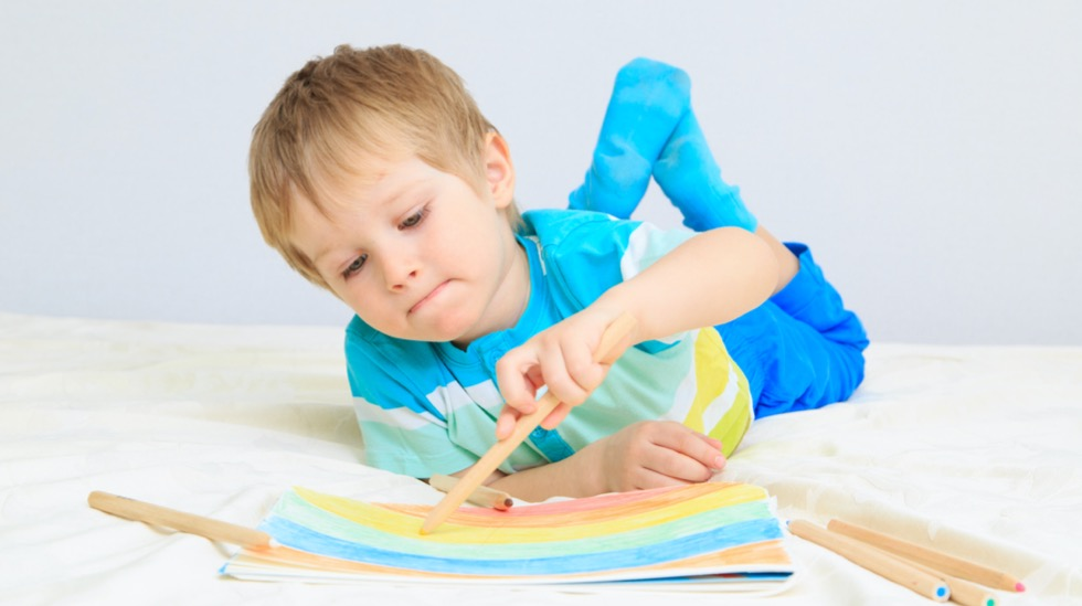 little-boy-drawing-picture-id479105229