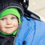 portrait-of-cute-caucasian-toddler-boy-in-black-hooded-warm-insulated-picture-id1276839951