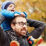hes-making-daddys-shoulders-his-playground-picture-id1201605450