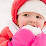 portrait-of-a-child-eating-snow-concept-of-a-holiday-emotions-of-picture-id1281642100