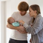 concerned-new-parents-holding-and-rocking-crying-baby-picture-id1197816117