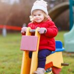cute-toddler-girl-having-fun-on-playground-happy-healthy-little-child-picture-id1302618466