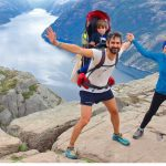 cheerful-couple-and-their-little-kid-in-the-summit-of-the-pulpit-rock-picture-id1091937476