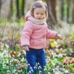 cute-toddler-girl-standing-in-the-grass-with-many-snowdrop-flowers-in-picture-id1208181249 (1)