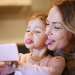 mother-with-daughter-making-funny-face-picture-id641198306